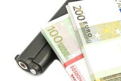 Banknotes and gun Royalty Free Stock Photo