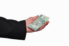 Banknotes in hand. Banknotes lying on the hand on a white background Royalty Free Stock Image