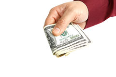 Banknotes in hand on a white background. Stock Photos