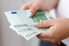 Banknotes in hands Stock Photography