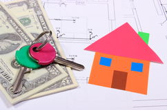 Banknotes, home of colored paper and keys on drawing of house Stock Photos