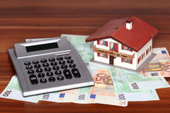 Banknotes and house Stock Images