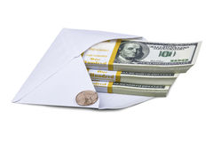 Banknotes on hundred dollars and coin in envelope Royalty Free Stock Image