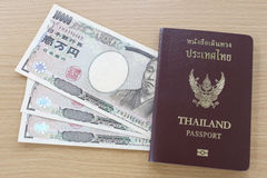 Banknotes of Japan in thai passport. Stock Image