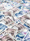 Banknotes of the Japanese yen currency. Many of the Japanese yen currency notes Stock Photos