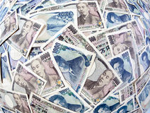 Banknotes of the Japanese yen currency. Many of the Japanese yen currency notes Stock Photo