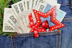 Banknotes in jeans pocket on Christmas gifts - Christmas shopping Royalty Free Stock Images