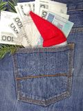 Banknotes in jeans pocket on Christmas gifts - Christmas shopping Royalty Free Stock Image