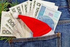 Banknotes in jeans pocket on Christmas gifts - Christmas shopping Royalty Free Stock Photo