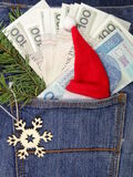 Banknotes in jeans pocket on Christmas gifts - Christmas shopping Stock Photos