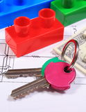 Banknotes, keys and building blocks on drawing of house Stock Image