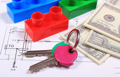 Banknotes, keys and building blocks on drawing of house Royalty Free Stock Photo