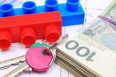 Banknotes, keys and building blocks on drawing of house Royalty Free Stock Photos