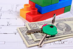 Banknotes, keys and building blocks on drawing of house Stock Images