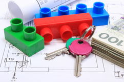 Banknotes, keys, building blocks and electrical diagrams on drawing of house Royalty Free Stock Photo