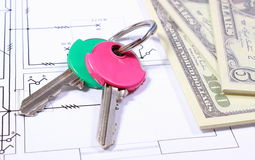 Banknotes and keys on construction drawing of house Stock Photo
