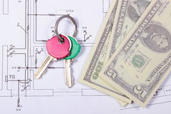 Banknotes and keys on construction drawing of house Stock Photography