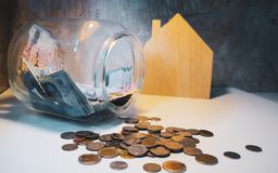 Banknotes in large glass jars and lots of coins. Collected to bu stock photography