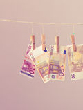 Banknotes on laundry line. Banknotes cash money hang on laundry line. Filtered Stock Photography