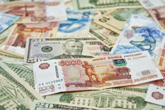 Banknotes lie mixed. Dollars, rubles and new jubilee 100 ruble Sochi 2014 Olympic banknotes Stock Photo