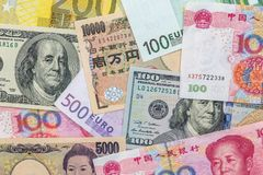 Banknotes of the most dominant countries in world - dollar, euro, yuan, yen. Stock Images