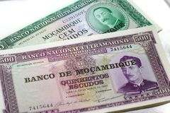 Banknotes of Mozambique on a white satin background. Stock Images
