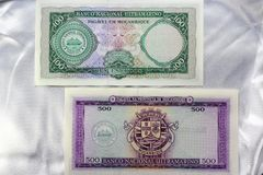 Banknotes of Mozambique on a white satin background. Royalty Free Stock Photography