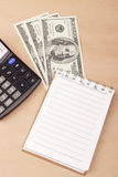 Banknotes, notepad, calculator Royalty Free Stock Images