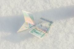 Banknotes of the old swedish krones in snow Stock Photo