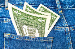 Banknotes of one american dollar sticking out of the back jeans Stock Image