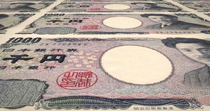 Banknotes of one thousand yen japanese rolling on screen, cash money, loop. Series of banknotes of one thousand yen japanese of Japan bank rolling on screen stock video footage