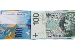 Banknotes of 100 PLN and swiss franc Stock Photos
