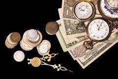 Banknotes and retro clocks Stock Photo