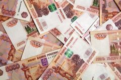 Banknotes of Russian currency face value of 5,000 rubles scattered on the table. Are a sign of riches and prosperity royalty free stock images