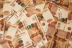 Banknotes of Russian currency face value of 5,000 rubles scattered on the table. Are a sign of riches and prosperity stock photo