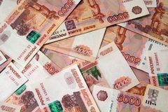 Banknotes of Russian currency face value of 5,000 rubles. Scattered on the table are a sign of riches and prosperity royalty free stock images