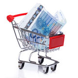 Banknotes in small shopping trolley Stock Photo