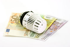 Banknotes with Thermostat. Banknotes with heating Thermostat on bright background royalty free stock image