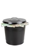 Banknotes in a trash can Royalty Free Stock Image