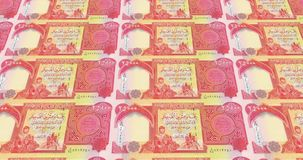 Banknotes of twenty five thousand dinars iraq rolling, cash money, loop. Series of banknotes of twenty five thousand iraqi dinars of the central bank of Iraq stock illustration