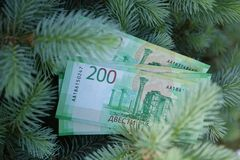 Banknotes Two hundred Russian rubles. Cash paper green money on green spruce. Finance royalty free stock photography