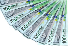 Banknotes of 100 US dollars and 100 euro lie a fan Royalty Free Stock Photos