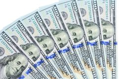 Banknotes of 100 US dollars are located around one on another Royalty Free Stock Photography