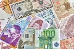 Banknotes of various currencies. Background of the banknotes of various currencies Stock Photo