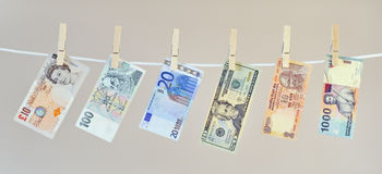 Banknotes on washing line Royalty Free Stock Image