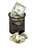 Banknotes in wastebasket Royalty Free Stock Photo