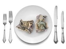 Banknotes on white plate with knife and fork, Royalty Free Stock Photo
