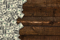 Banknotes on wooden background Stock Images