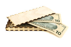 Banknotes in a wooden box Stock Images