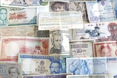 Banknotes from the World and the US. Old cash money from different countries around the world. With a twenty dollar US dollar bill on top Royalty Free Stock Photo